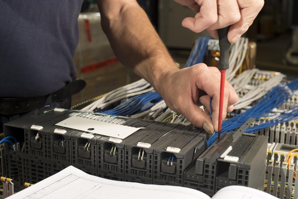Technician Fixing Industrial Control
